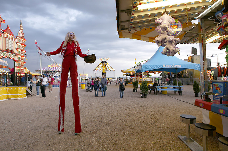 Manda Ellison walks around the Larimer County Fair on stilts.
