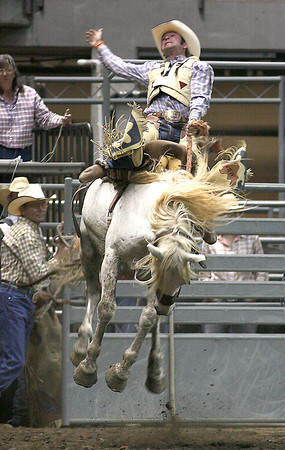 Jake Griffin competes in the saddle bronc riding competition during the Larimer County Fair Rodeo on Sunday at the Budweiser Events Center.
