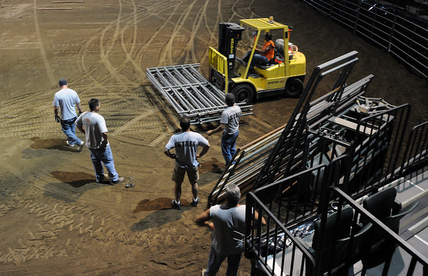 Budweiser Events Center crews set up the fences and chutes for the rodeo in the Dale Wiest Arena on Thursday. The 130th annual Larimer County Fair starts July 31.
