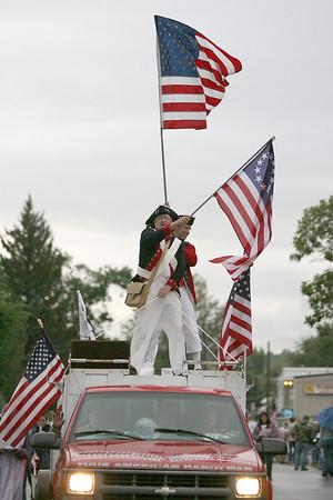 Members of Loveland 9-12 wave American flags.
