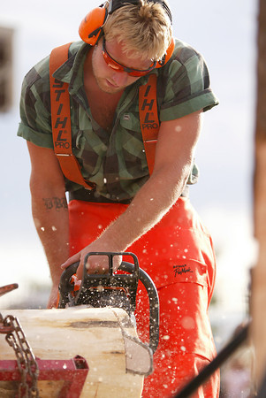 Derek Knutson competes in a log-cutting competition.