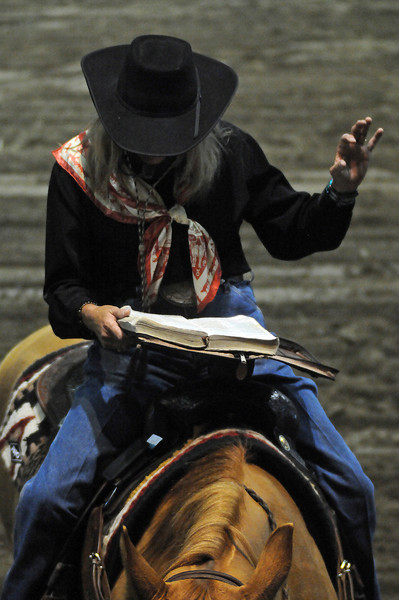 Crystal Lyons of Mason, Texas preaches to a crowd assembled at the Budweiser Events Center from atop a horse named Dunny.