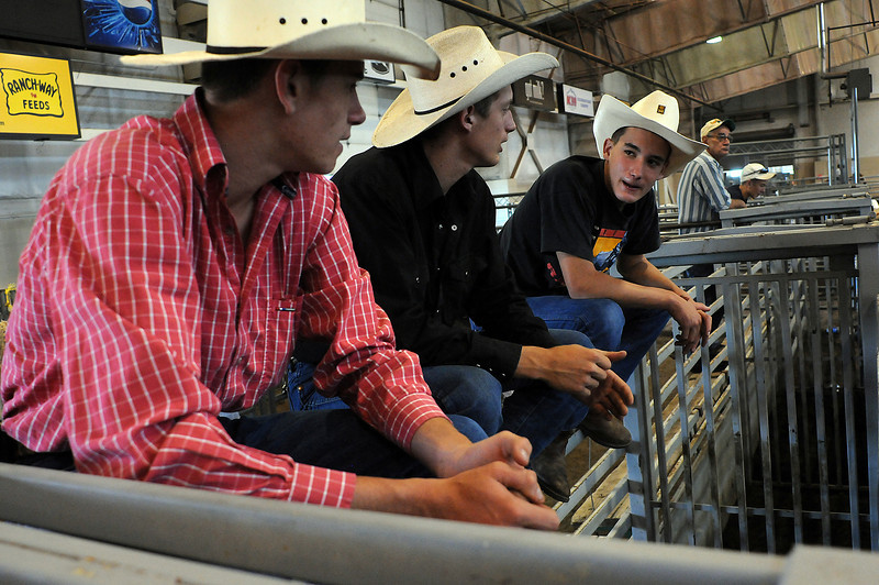 From left, Casey Lubin, 16, Cody Budy, 18, and Colton Perry, 16, of Wellington watch the flag event during the Junior Rodeo on Sunday at The Ranch.