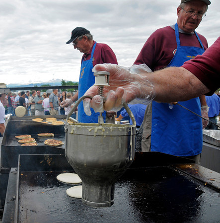 Lloyd Geriner, right, puts some finished pancakes away while Carl Bosack continues to cook on Sunday at the Ranch in Loveland. The free pancake breakfast used over 1500 plates and served even more pancakes.