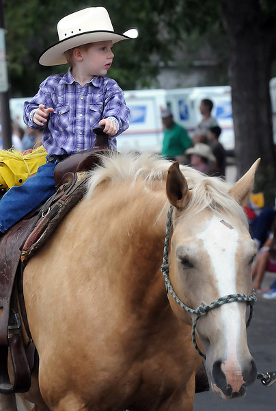 Sean Barch, 2, rides atop a horse named Tony during the Larimer County Fair parade on Wednesday, Aug. 4, 2010 in downtown Loveland.