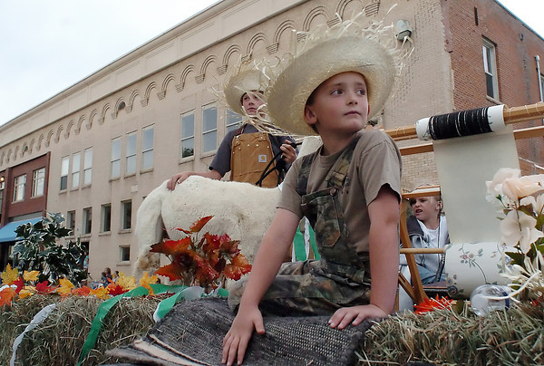 Youngsters ride atop the Timnath Goal Diggers 4-H Club's float during the Larimer County Fair parade Wednesday evening in downtown Loveland. At front is Braden Bensley, 7, and at rear from left are Gavin Amen, 12, and Jasmine Amen, 5.