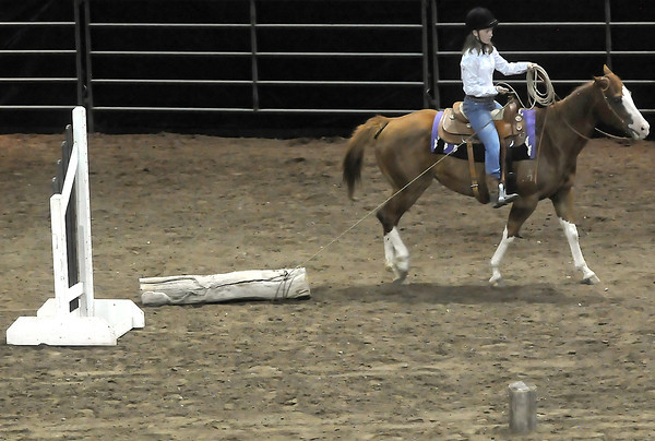 McKenna Adams, 13, of Loveland rides her horse, Diamond, during the working ranch horse trail competition Tuesday at the Budweiser Events Center.