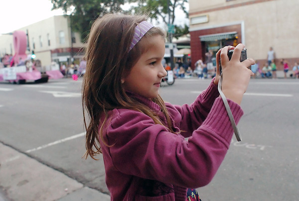 Annalina Scalise, 8, takes pictures during the Larimer County Fair parade on Wednesday, Aug. 4, 2010 in downtown Loveland.