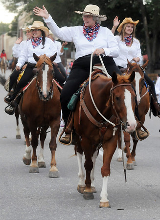 Windsor resident Deb Meyer, front, rides with other members of the Northern Colorado Trail Riders during the Larimer County Fair parade on Wednesday, Aug. 4, 2010 in downtown Loveland.