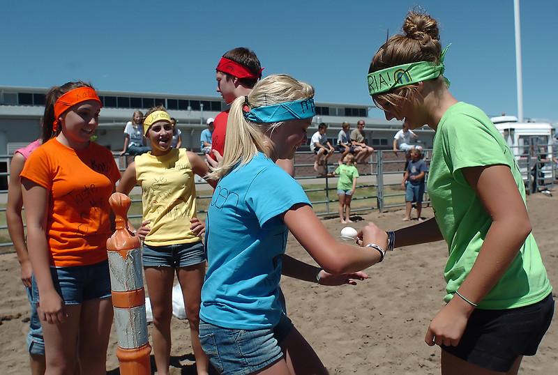 "Members of the ""Taste the Rainbow"" team compete in an egg race during the Larimer County Fair's Wild and Crazy Kids Day on Tuesday at The Ranch. From left are Zach Hooker, 14, Katie Riley, 14, Jordan Pollema, 15, Clancey Lee, 16, Maddie Schoen, 13, and Victoria Warren, 15."