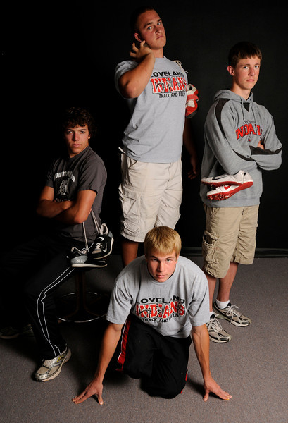 Trevor Floyd, left, Callen Hecker, middle standing, Casey Riggs, right, and Blake Berens, kneeling, pose for a portrait. All four boys were named All-Area in track and field this year.