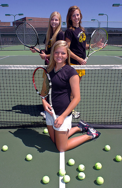 All area tennis players Jen Weissmann of Loveland, center, and Thompson Valley doubles players Emily Erickson, left, and Lexi Newgord.