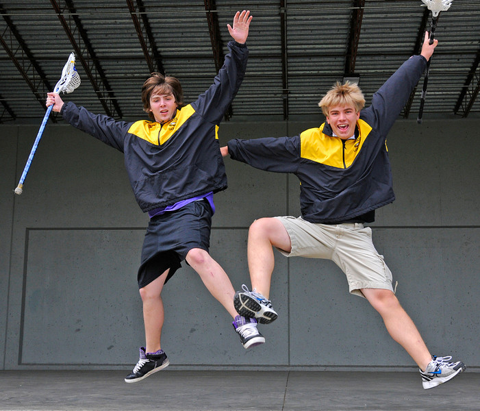 Loveland High School Seniors Trevor Pearman, left, and Steven Boggess jump off the stage at the North Lake Amphitheater on Wednesday. Pearman, an attack, and Boggess, a goalie, were both named all-area in lacrosse this year.
