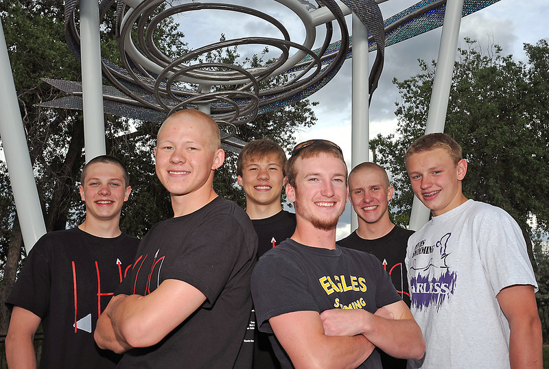 All-area swim and dive team members include, front from left, swimmer of the year Brandon Hatanaka of Loveland High School and diver of the year Travis Hartman from Thompson Valley. At rear are Loveland's Ethan McNally, Nick Hatanaka, and Pat Jones and Alex Nickell of Mountain View.