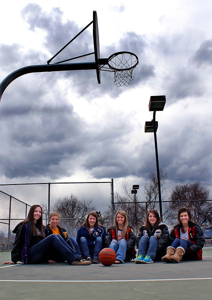 All-area girl's basketball players, from left, Courtney Boynton of Mountain View, Cassie Baalke of Thompson Valley, Sarah Wallman of Resurrection Christian, Bradey King of Loveland, Becky Eidson of Roosevelt, and Michelle Petrie of Loveland, pose for a photo Sunday afternoon at Dwayne Webster Veteran's Park in Loveland, Colo. Bradey King has been named the Reporter-Herald's girl's basketball player of the year.