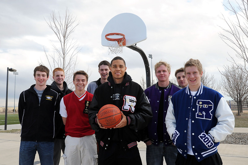 Members of the all-area basketball team, from left, Thompson Valley High School's Jonny Pomerleau and Collin Smith, Loveland's Joe Etling and Conor Lang, player of the year Michael Mitchell of Roosevelt, Mountain View's Josh Sandin and Resurrection Christian's Brock Buxman and Wyatt Simon.