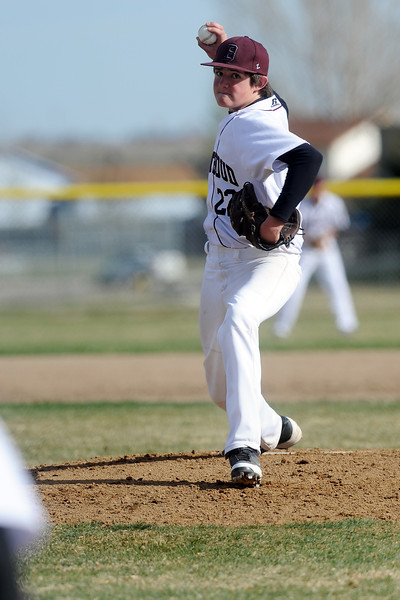 Berthoud High School's Cole Brakhage winds up before throwing a pitch in the top of the third inning of a game against Resurrection Christian on Thursday, April 5, 2012 at Sommers Field.