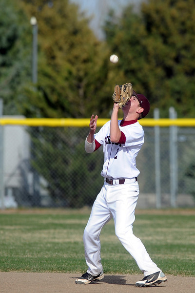 Berthoud High School shortstop Luke Whitfield catches a pop fly in the top of the fourth inning of a game against Resurrection Christian on Thursday, April 5, 2012 at Sommers Field.
