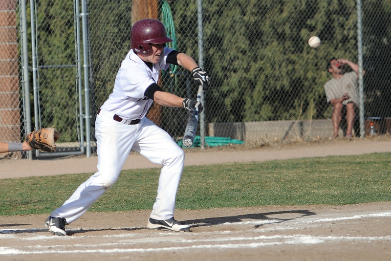 Berthoud High School's Ryan DeMoudt hits a sacrifice bunt in the bottom of the fifth inning of a game against Resurrection Christian on Thursday, April 5, 2012 at Sommers Field.