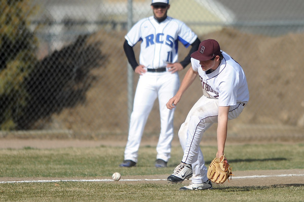 Berthoud High School third baseman Zach Bracken fields a ground ball in the top of the fourth inning of a game against Resurrection Christian on Thursday, April 5, 2012 at Sommers Field.