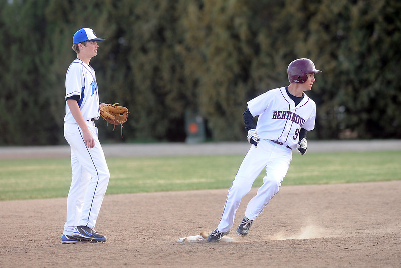 Berthoud High School baserunner Erik Maas steps on second for a steal in front of Resurrection Christian's Luke Mondt in the bottom of the sixth inning of their game on Thursday, April 5, 2012 at Sommers Field.