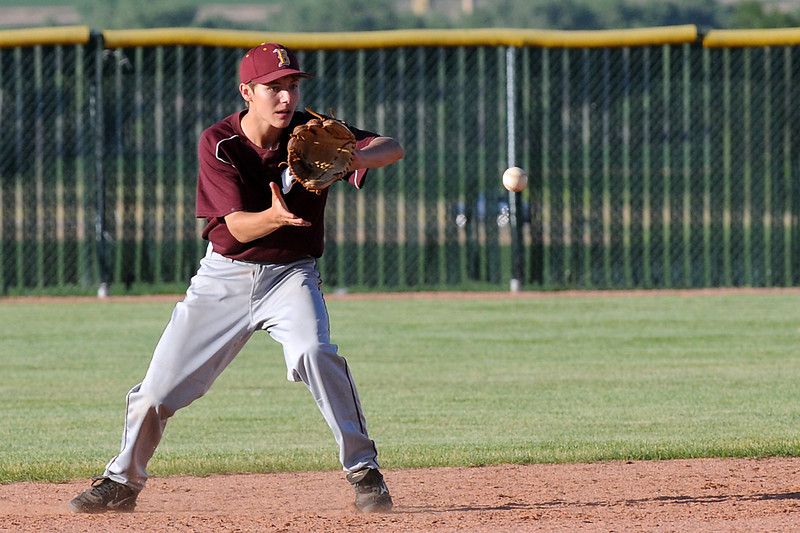 Berthoud High School second baseman Austin Bendin fields a ground ball in the bottom of the fourth inning of a game against Legion Post 70 on June 22, 2011 in Johnstown.