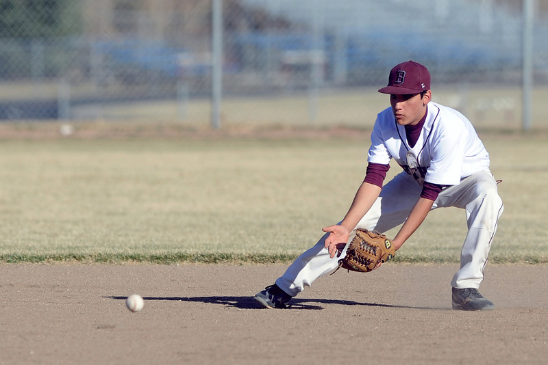 Berthoud High School shortstop Vincent Grine fields a ground ball in the top of the third inning of a game against Fort Morgan on Saturday at Sommers Field.
