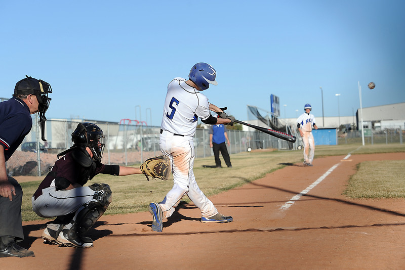 Resurrection Christian School's Luke Mondt (5) hits a single in the bottom of the fifth inning of a game against Berthoud on Friday, March 23, 2012 at RCS. The Cougars won in five innings, 12-2.