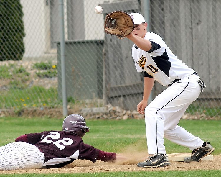 Thompson Valley High School's Caleb Carlson covers first base on a pickoff attempt of Berthoud's Colton Moore in the top of the fourth inning of their game on Saturday, May 1, 2010 at Constantz Field. The Eagles won in five innings, 12-2.