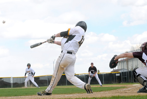 Berthoud High School catcher Jacob Sproles looks on while Thompson Valley's Max Schoen smacks hit a to drive in three runs and advance to second base on a misplayed ball in the bottom of the fifth inning of their game on Saturday, May 1, 2010 at Constantz Field. The Eagles won in five innings, 12-2.