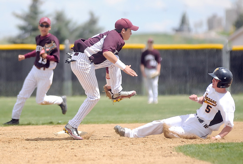 Thompson Valley High School's Chaz Moore slides safely into second base for a steal ahead of the tag by Berthoud shortstop Luke Read while second baseman Vinny Grine (13) backs up on the play in the bottom of the fifth inning of their game on Saturday, May 1, 2010 at Constantz Field. The Eagles won in five innings, 12-2.