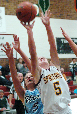 Berthoud High School senior Amy Ekart takes a shot in front of Greeley West's Sara Krammer in the first quarter of their game on Friday, Dec. 11, 2009 at BHS.