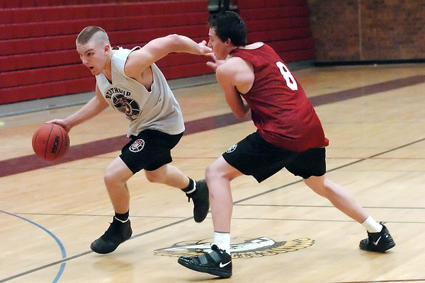 Berthoud High School senior Joel Maly, left, drives to the basket around Graham Shaw during practice Monday at the school.