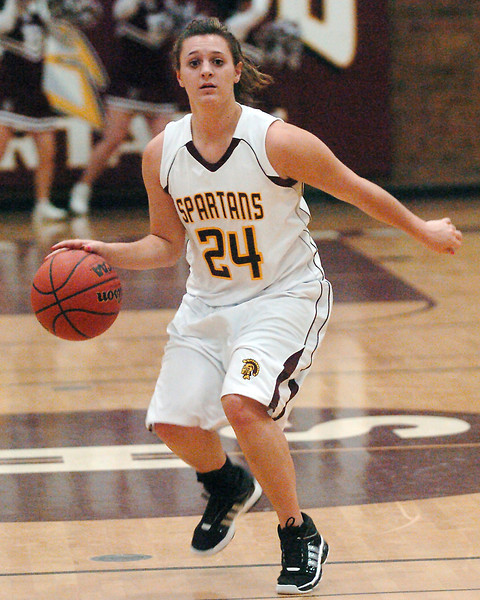 Berthoud High School junior Danielle Wikre dribbles upcourt during a game against Greeley West on Friday, Dec. 11, 2009 at BHS.