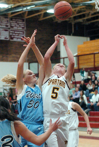Berthoud High School senior Amy Ekart, right, and Greeley West's Kirstin Franklin go up for a rebound in the second quarter of their game on Friday, Dec. 11, 2009 at BHS.