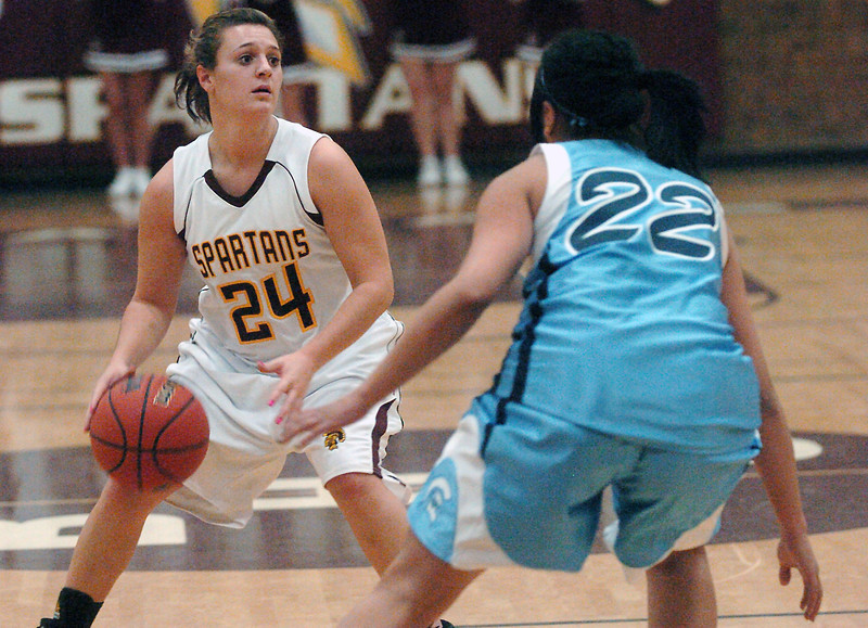 Berthoud High School junior Danielle Wikre dribbles upcourt under defensive pressure from Greeley West's Danielle Saucedo in the first quarter of their game on Friday, Dec. 11, 2009 at BHS.
