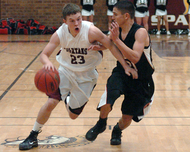 Berthoud High School sophomore Zach Ruebesam drives to the basket around Roosevelt's Jordan Grado in the third quarter of their game on Friday, Dec. 18, 2009 at BHS. The Spartans won, 63-53.