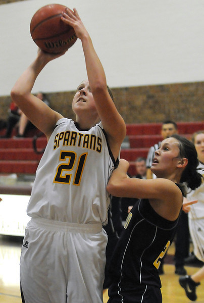 Berthoud High School sophomore Lindsey Loberg (21) takes a shot in front of Thompson Valley's Brooke Podtburg in the second quarter of their game Thursday at BHS. Thompson Valley won, 54-28.