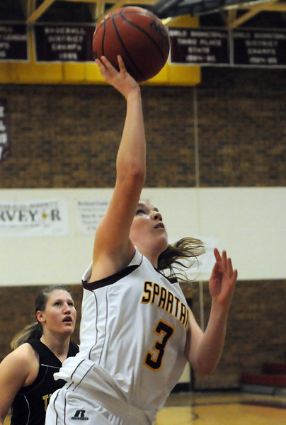 Berthoud High School senior Megan McGinn (3) puts up a shot in front of Thompson Valley's Jordan Sibrel in the second quarter of their game Thursday at BHS. The Eagles won, 54-28.