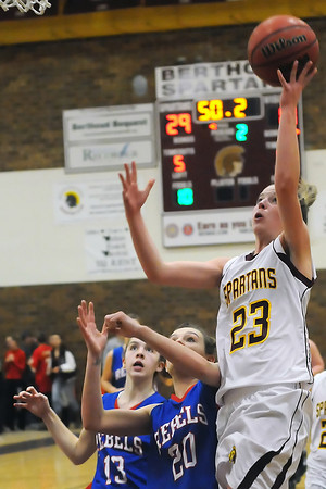 Berthoud High School senior Julia Perry (23) puts up a shot in front of Weld Central's Emily Smilek (13) and Krystina Kilker (20) in the second quarter of their game Tuesday, Feb. 8, 2011 at BHS. The Spartans won, 53-42.