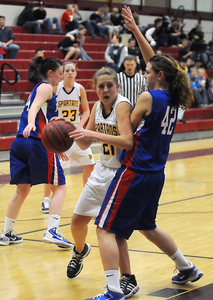 Berthoud High School sophomore Lindsey Loberg (21) drives to the basket around Weld Central defender Ivannie Robertson in the second quarter of their game on Tuesday, Feb. 8, 2011 at BHS. The Spartans won, 53-42.