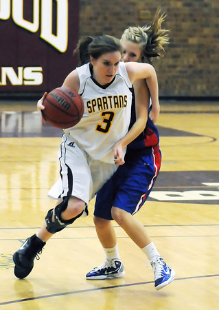 Berthoud High School senior Megan McGinn (3) dribbles past Weld Central's Nicole Mettler in the third quarter of their game Tuesday, Feb. 8, 2011 at BHS. The Spartans won, 53-42