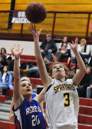 Berthoud High School senior Megan McGinn (3) puts up a shot in front of Weld Central defender Krystina Kilker in the third quarter of their game Tuesday, Feb. 8, 2011 at BHS. The Spartans won, 53-42.