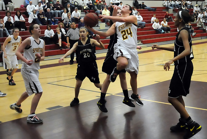 Berthoud High School junior Danielle Wikre goes up for a shot while teammates Megan McGinn, left, and Julia Perry look on in the third quarter of their playoff game against Prairie View on Tuesday, Feb. 23, 2010 at BHS. Berthoud won, 50-37.