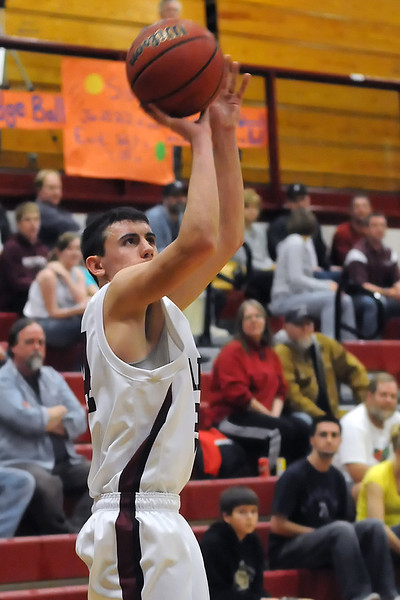 Berthoud High School's Gregory Hutchins shoots a three-pointer in the second quarter of a game against Niwot on Saturday at BHS.