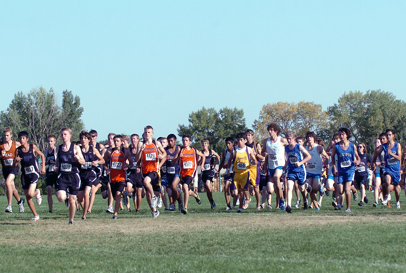 Runners take off at the start of the boys combined heat Friday during the Sweetheart Invitational cross-country meet at North Lake Park.