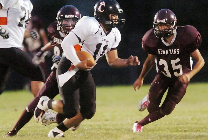 Berthoud High School defenders Jesse Lyman, right, and Cory Ellis track down Greeley Central quarterback  Jordan Tellez in the second quarter of their game on Friday, Aug. 27, 2010 at Marr Field in Berthoud.