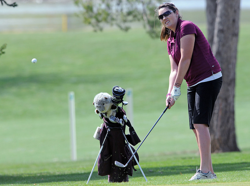 Berthoud High School senior Stephanie Heaton hits a chip shot on hole No. 9 during a northern conference meet Thursday at the Olde Course.