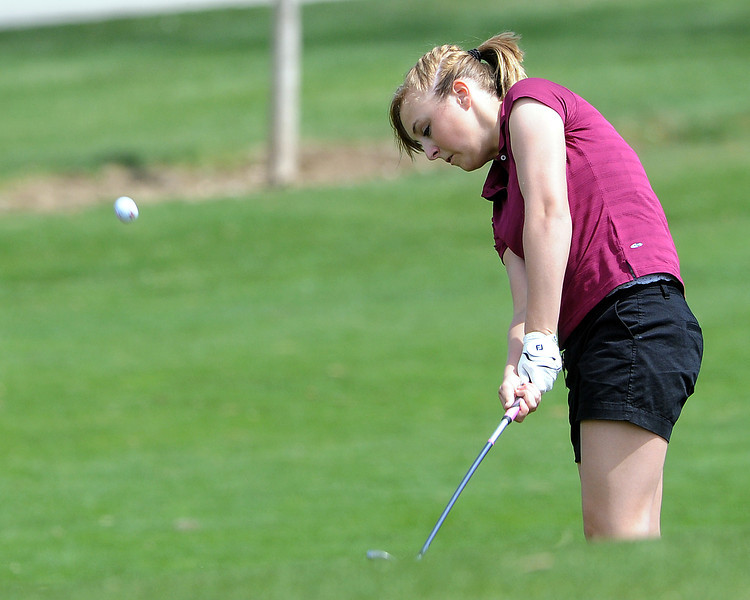 Berthoud High School sophomore Brandy Peter hits an approach shot on hole No. 5 during a northern conference meet Thursday at the Olde Course.
