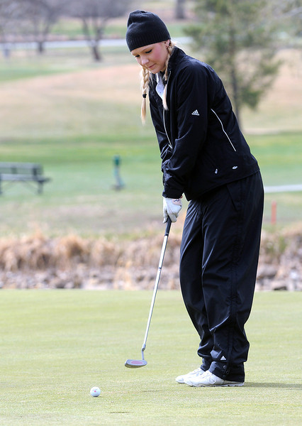 Berthoud High School junior Alyxis Petty watches her putt on the no. 6 green during a city golf tournament Wednesday, April 6, 2011 at The Olde Course in Loveland.
